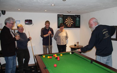 Branch members relax over a game of pool after the Pub of the Season presentation (Winter 2014) to the Turkey Inn, Goose Eye, Keighley