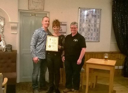Colleen presents Club of the Year 2018 award to Louise and Dale at Oakworth Social Club, April 2018
