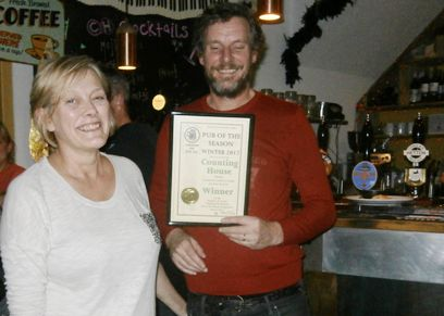 John and Annie show off their Pub of the Season plaque, Counting House, Silsden.