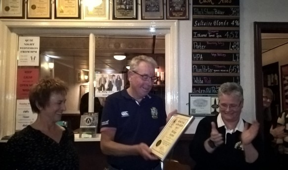 Chairman Coll presents a special award to Francis and Lisa at the Kings Arms, Silsden to celebrate 10 years in the CAMRA Good Beer Guide