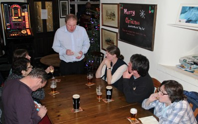 Branch members enjoy the mince pies, Pub of the Season presentation, the Turkey Inn, Goose Eye, Keighley, December 2014