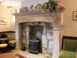 The old stone fireplace on the left in the main bar.