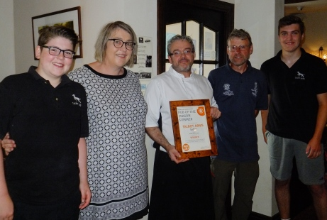 Richard Candeland presents Pub of the Season Summer 2018 award to Tony, Janette, Ethan and Harvey Clarke at the Talbot Arms, Settle, July 2018